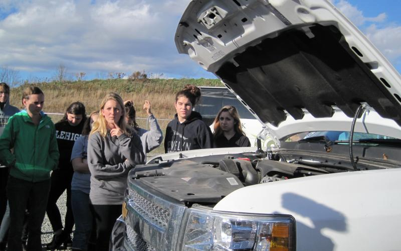 Lehigh students on a field trip looking at a truck converted to run on natural gas.